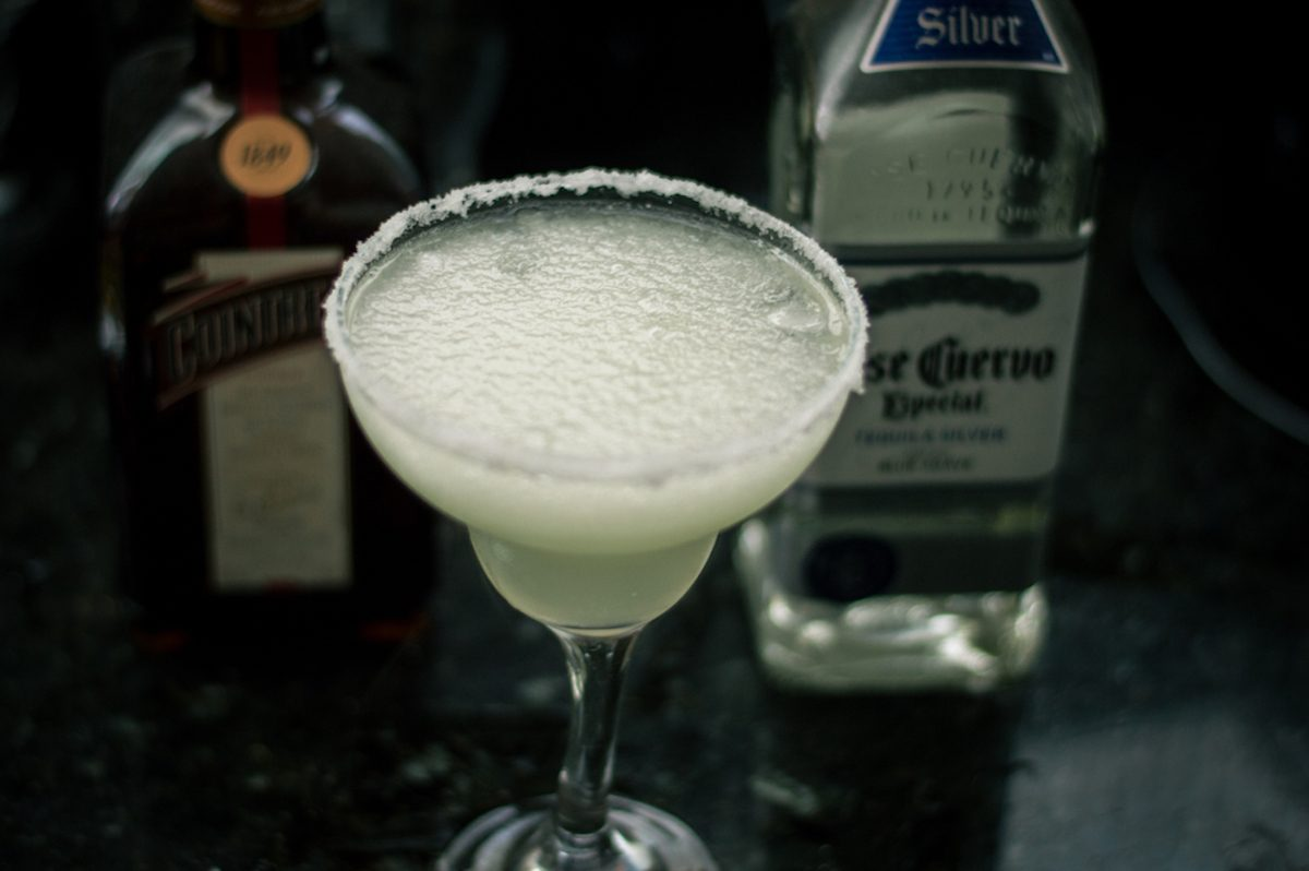 Frozen margarita drink with bottles of Jose Cuervo tequila and Cointreau triple sec in background; Shutterstock ID 1035698107; Job (TFH, TOH, RD, BNB, CWM, CM): TOH