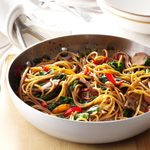 A skillet with Beef & Spinach Lo Mein
