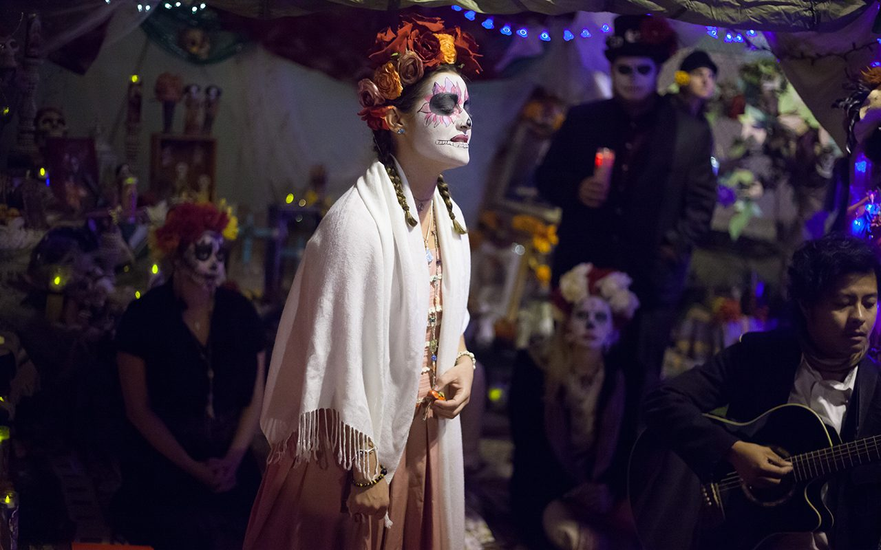 A woman sings at the event of the Day of the Dead, Mission District, San Francisco. Nov 2014