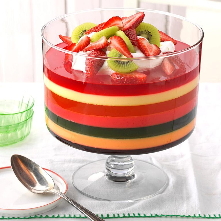 A glass trifle bowl with 7-Layer Gelatin Salad