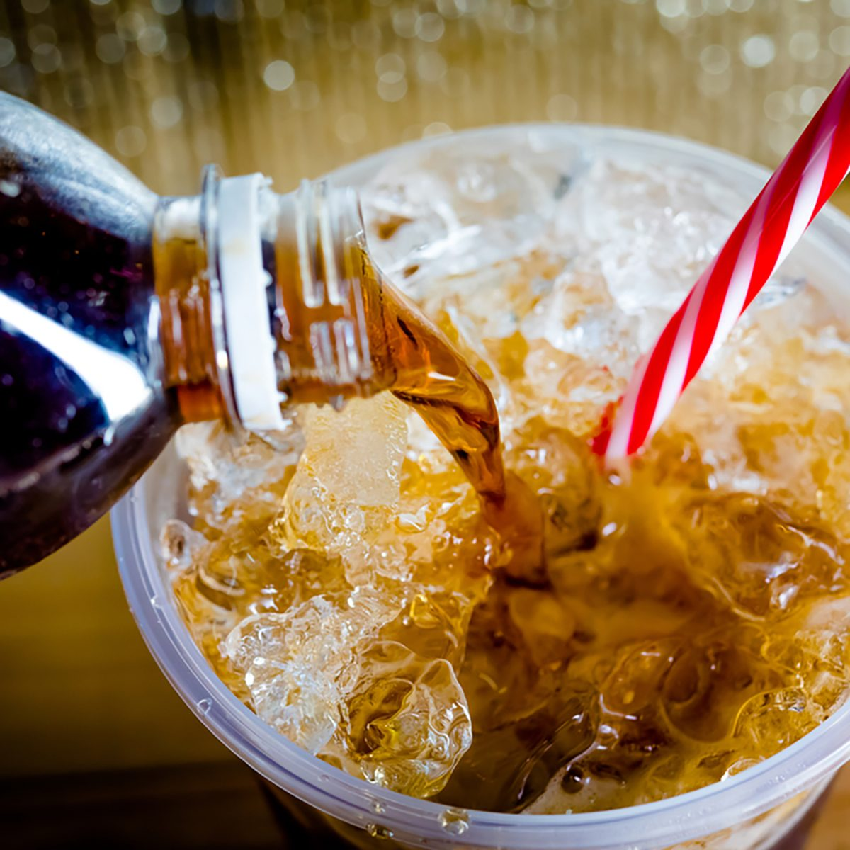 Refreshing Bubbly Soda Pop with Ice Cubes. Cold soda iced drink in a glasses - Selective focus, shallow DOF
