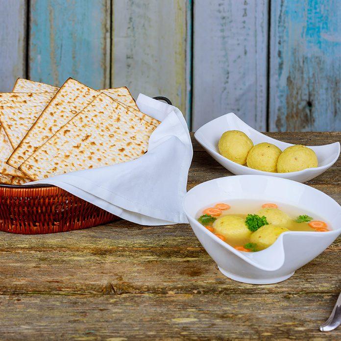 Traditional Jewish matzah ball soup, dumplings made from matzah meal ground matzo.