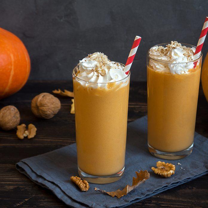 Pumpkin Smoothie. Fresh Pumpkin and Apple Smoothie or Milkshake with Walnuts and Autumn Spices. Seasonal Autumn Drink.