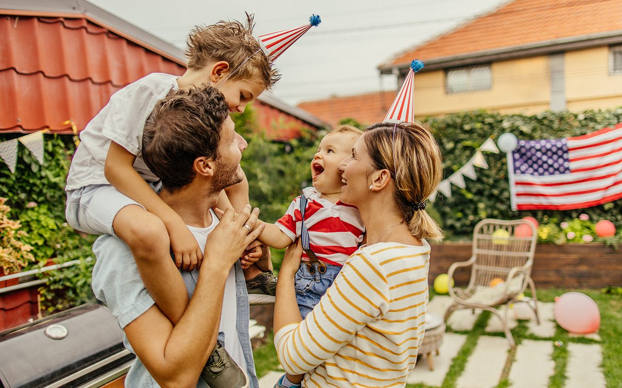 Photo of a happy family celebrating Fourth of July in their yard