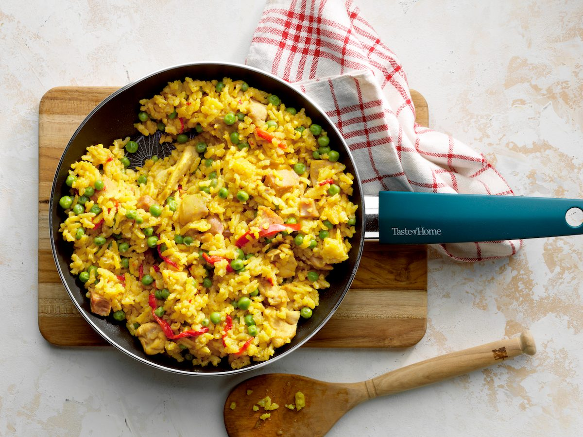29684 Chicken Paella; Overhead camera angle; Russian stucco light surface; TOH branded Skillet 12 inch Aluminum cookware Non-stick; wood cutting board; wooden spoon; white red cloth; white red linen
