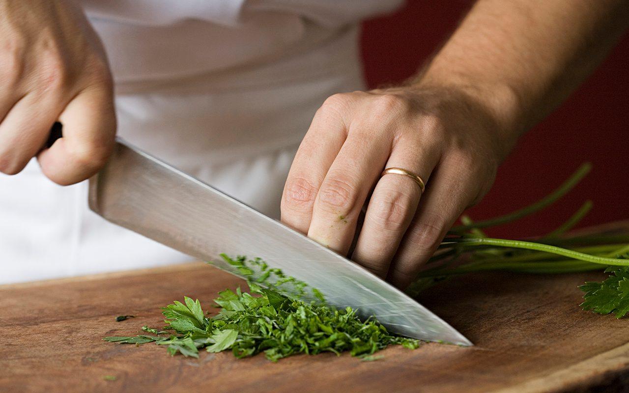 Chef chopping parsley