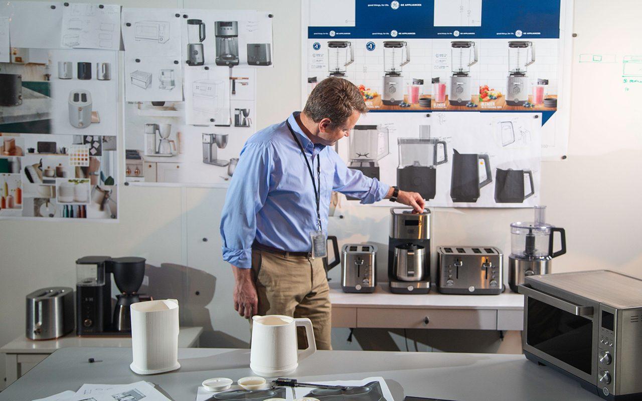 Man examining kitchen appliances