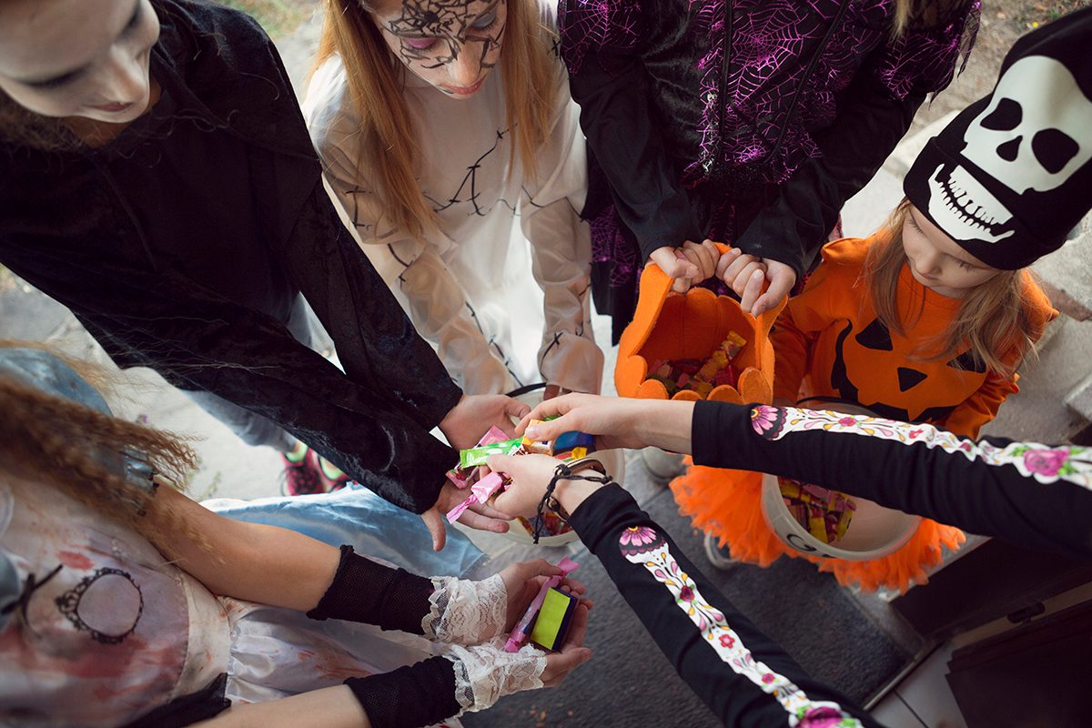 Group of children trick or treating for sweets on Halloween