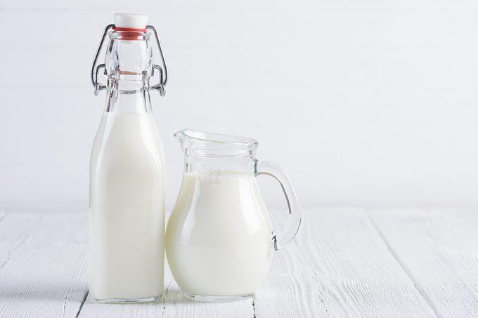 Jar With Milk And Vintage Bottle Of Milk
