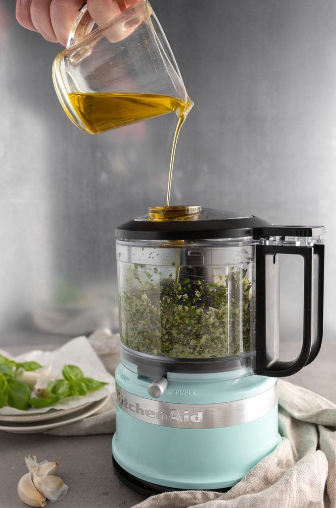 how to make pesto Slowly add the olive oil