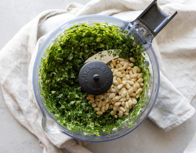 how to make pesto Add the toasted pine nuts