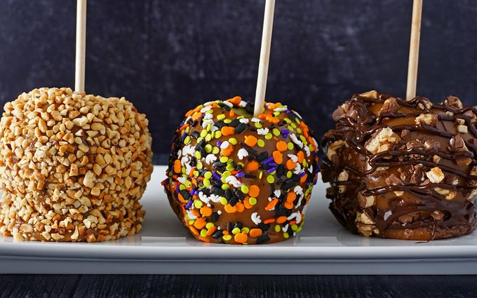 homemade caramel apples decorate with various toppings