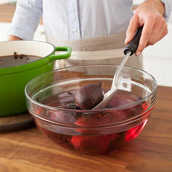 Remove beets to a bowl of cold water.