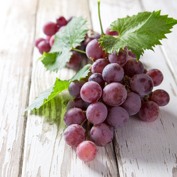 Grapes on wooden table, close-up.; Shutterstock ID 216882460; Job (TFH, TOH, RD, BNB, CWM, CM): Taste of Home