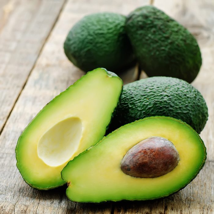 avocado on a dark wood background. tinting. selective focus; Shutterstock ID 263066309; Job (TFH, TOH, RD, BNB, CWM, CM): Taste of Home