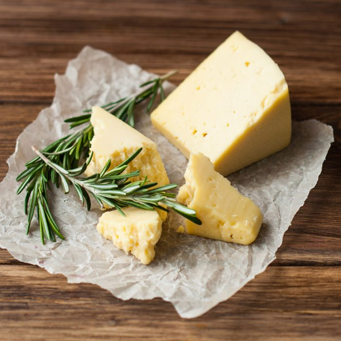 Hard cheese on a wooden table. Dairy products and agriculture.; Shutterstock ID 588101330; Job (TFH, TOH, RD, BNB, CWM, CM): Taste of Home