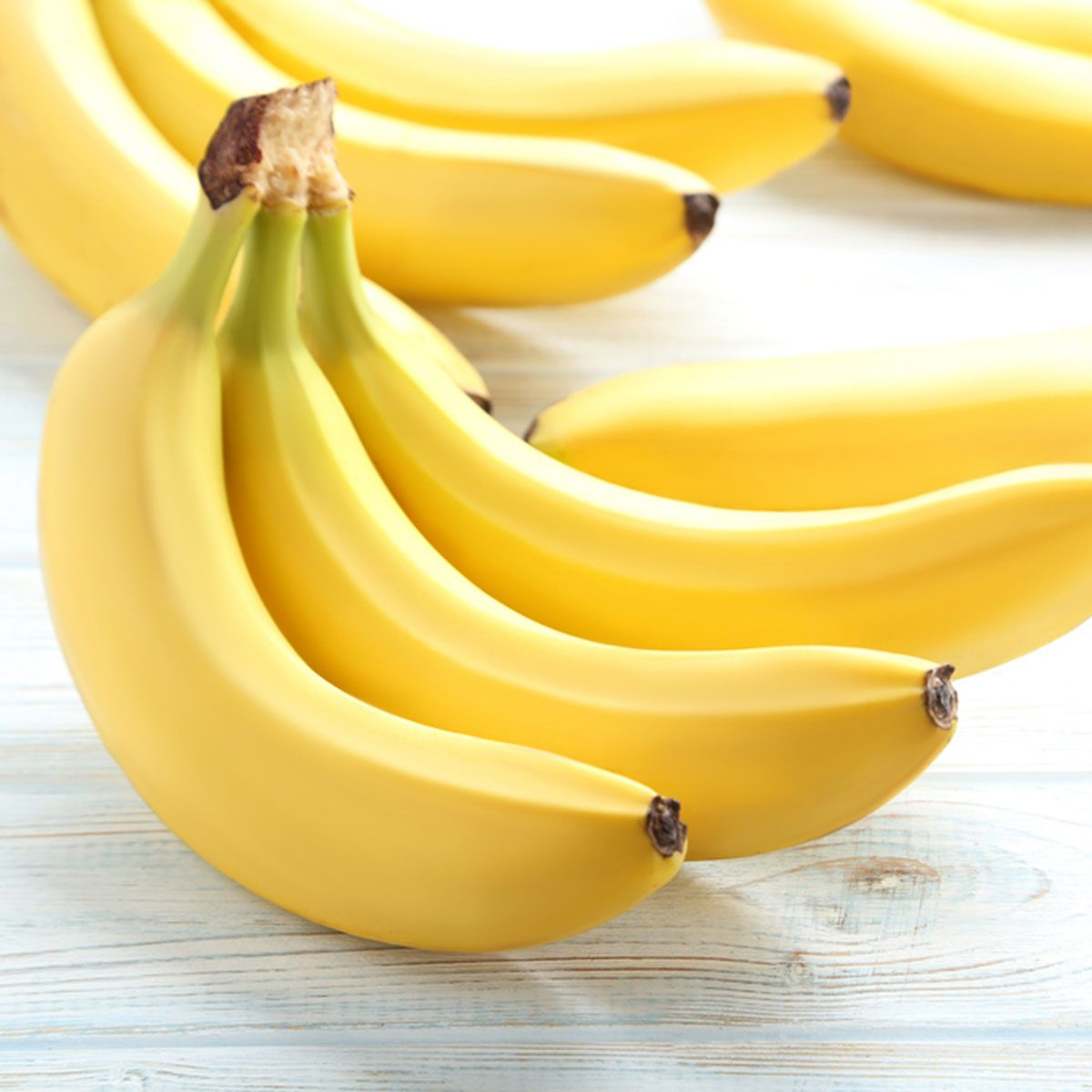 Sweet bananas on white wooden table; Shutterstock ID 626207750; Job (TFH, TOH, RD, BNB, CWM, CM): Taste of Home