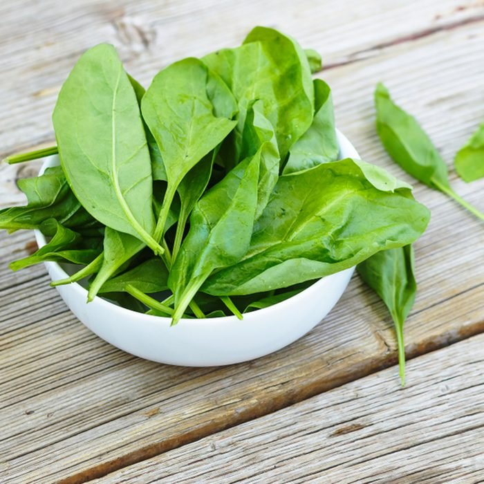 Baby spinach in a white bowl on a wooden board. Healthy food. Detox. Summer time; Shutterstock ID 793075156; Job (TFH, TOH, RD, BNB, CWM, CM): Taste of Home