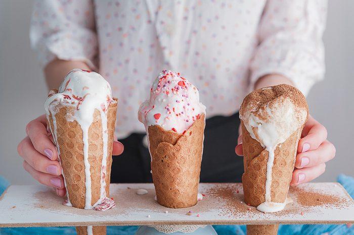Three ice cream cones on a wooden background