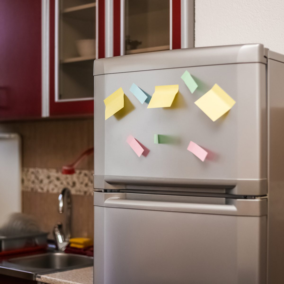 Empty paper sheet on refrigerator door with magnetic clip paper note for add text message.; Shutterstock ID 716205340; Job (TFH, TOH, RD, BNB, CWM, CM): TOH