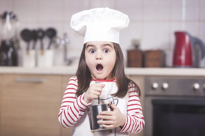 Surprised little girl chef reacts with open mouth; Shutterstock ID 614797985; Job (TFH, TOH, RD, BNB, CWM, CM): TOH