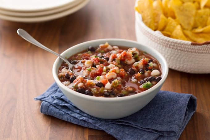 Homemade salsa in a bowl with another bowl nearby of tortilla chips