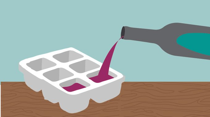 Juice being poured into an ice cube tray