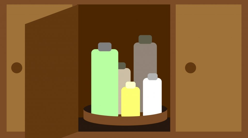 Cabinet filled with neatly stacked bottles