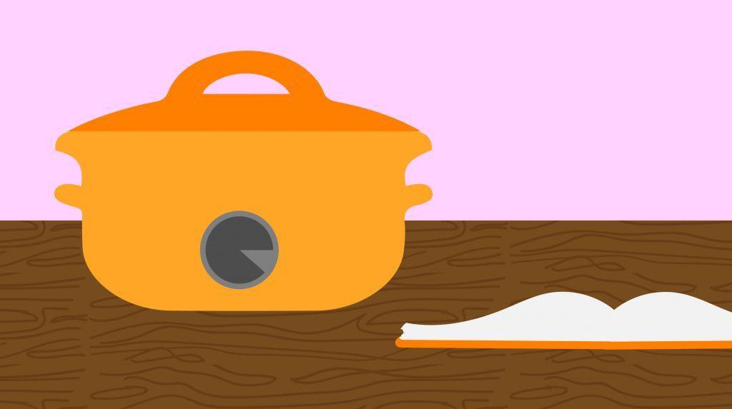 Orange slow cooker and a matching orange recipe book