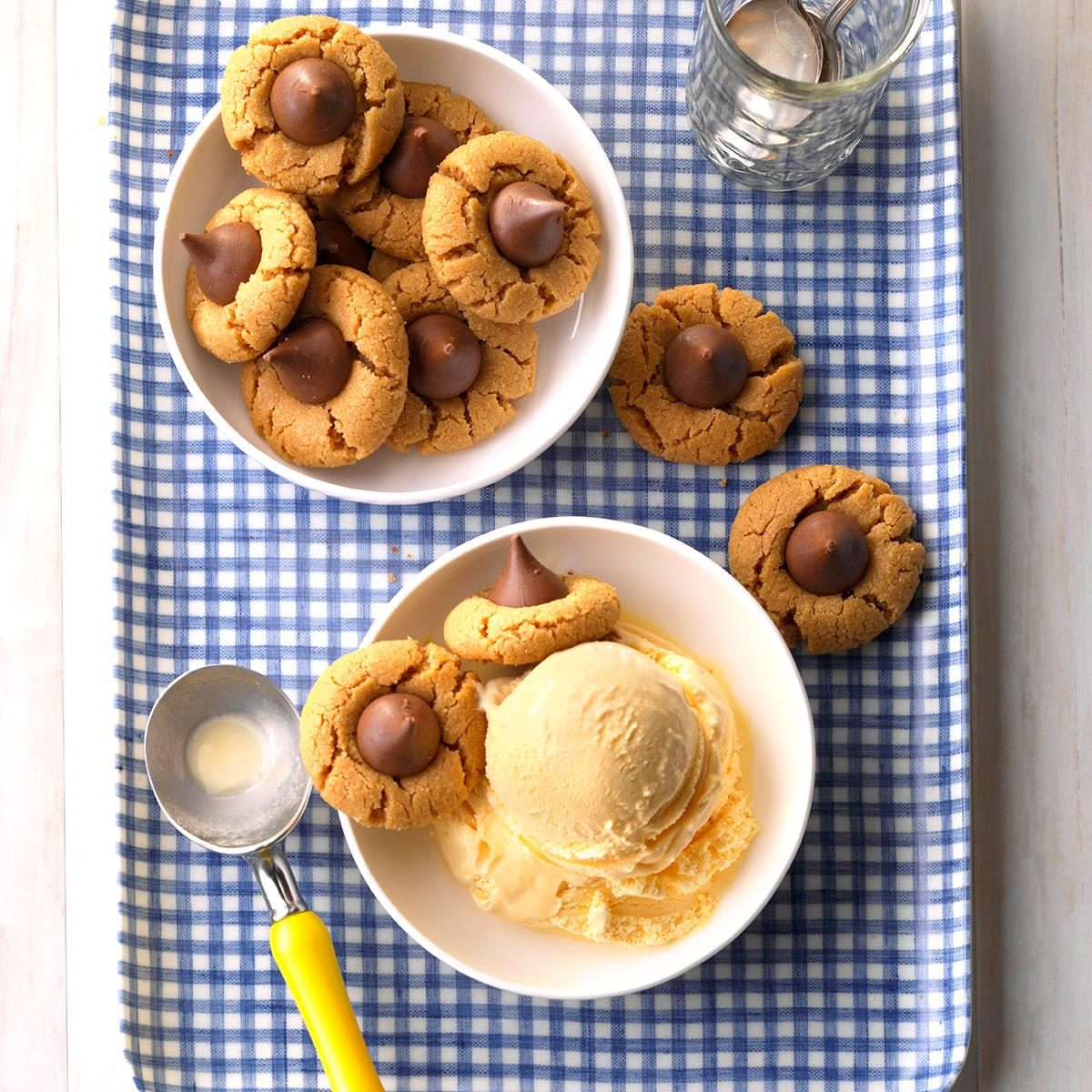 Bowl of peanutbutter kiss cookies with another bowl of ice cream