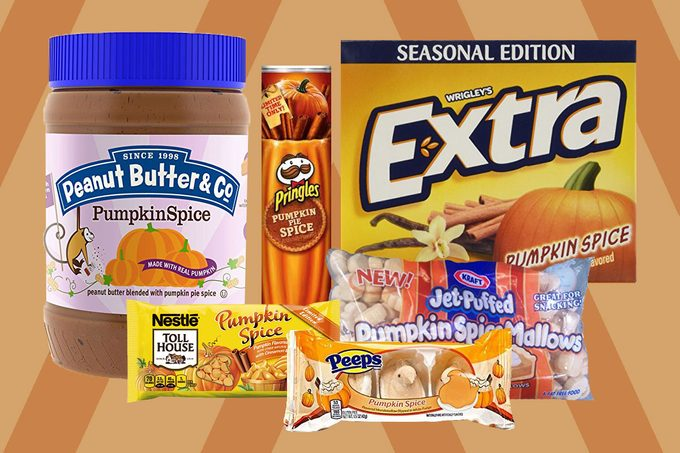 Various pumpkin spice flavored items lined up on an orange and brown striped background
