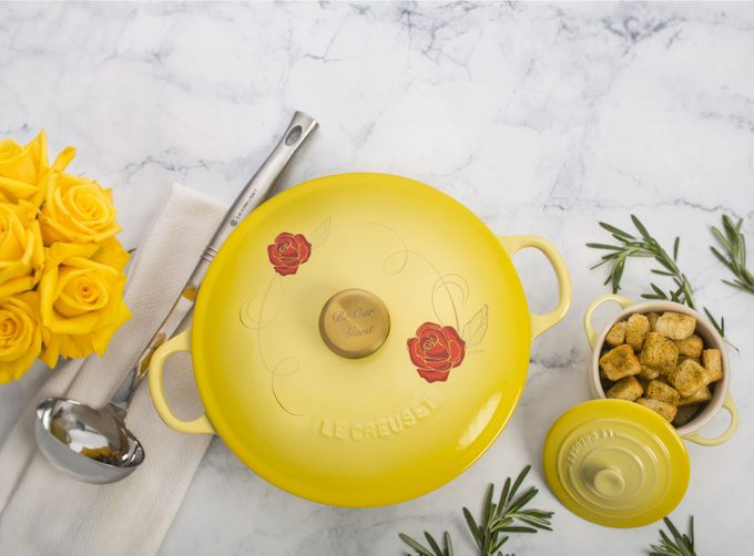 Yellow Disney-Themed Le Creuset Soup Pot with roses