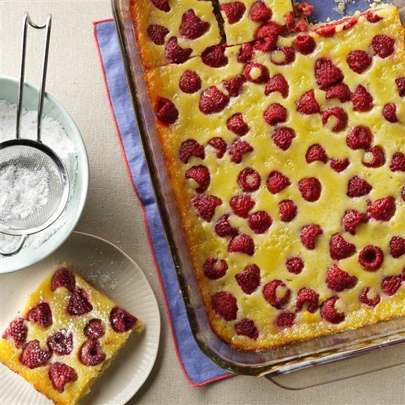 Rasberry Custard Kuchen in a 13x9 glass pan with one slice removed and on a separate plate
