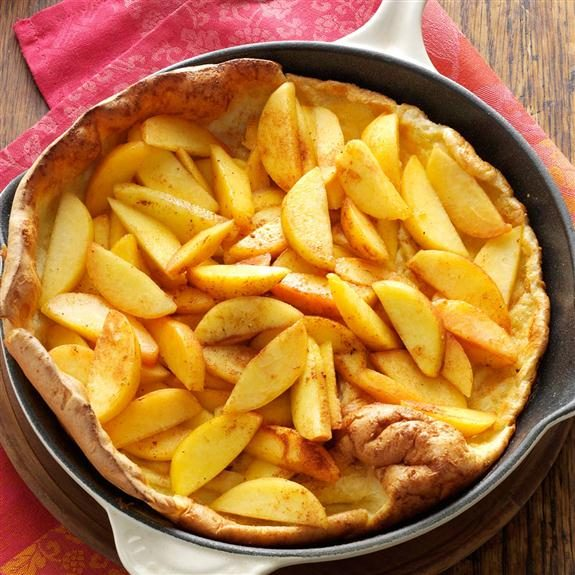 Baked peach pancake in a cast-iron skillet