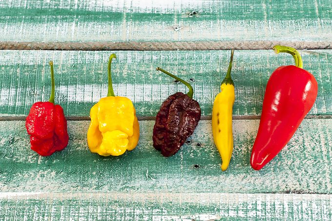 A line-up of different types of peppers