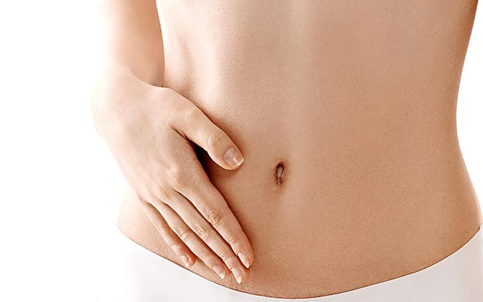 Woman holding a hand against her stomach