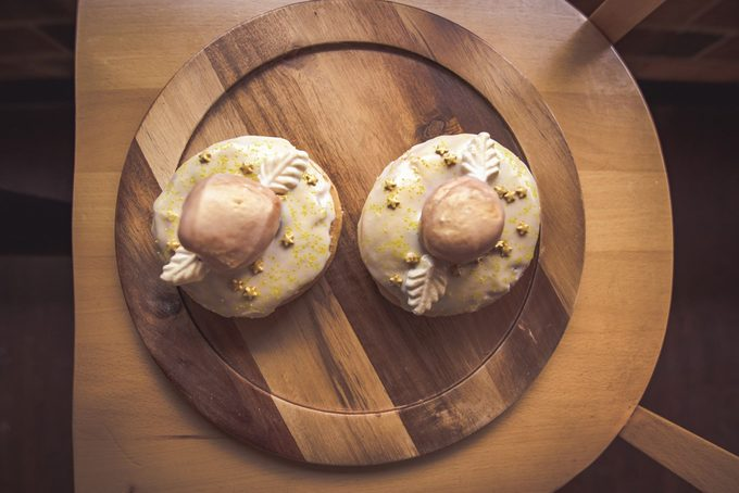 Two golden snitch themed donuts