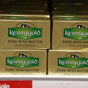 A supply of Kerrygold Pure Irish Butter sits amidst other butters on a store shelf