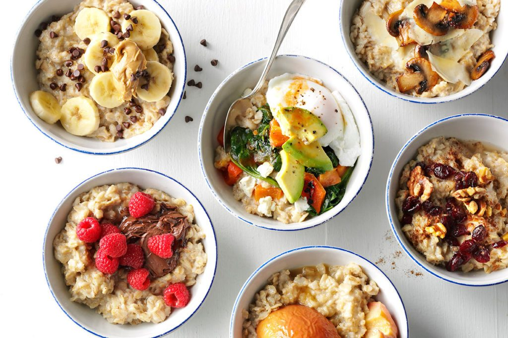 Six bowls of oatmeal each with different stir-ins