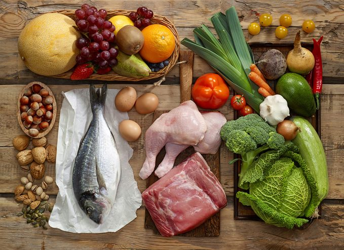 Various Paleo diet products on wooden table
