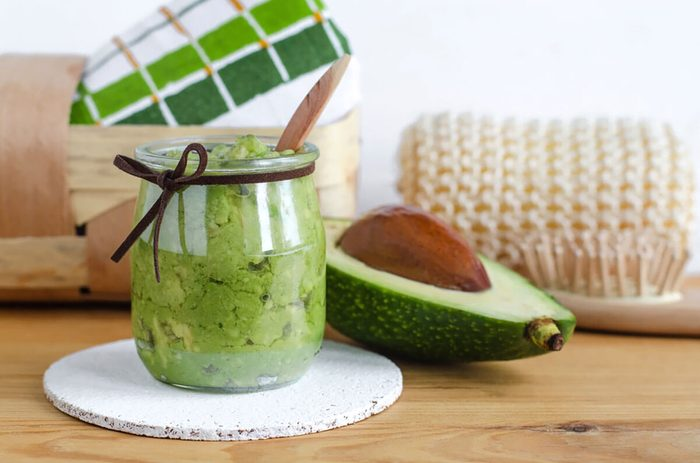 Homemade avocado mask in a glass jar.