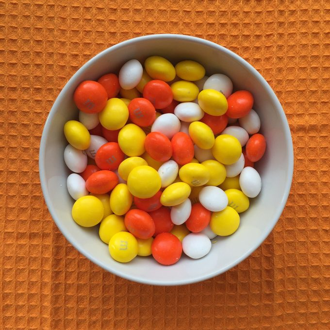 Bowl of candy corn M&Ms