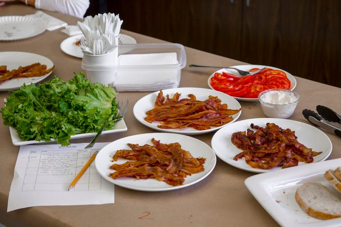 Plates of unmarked bacon sitting on a table ready for testing
