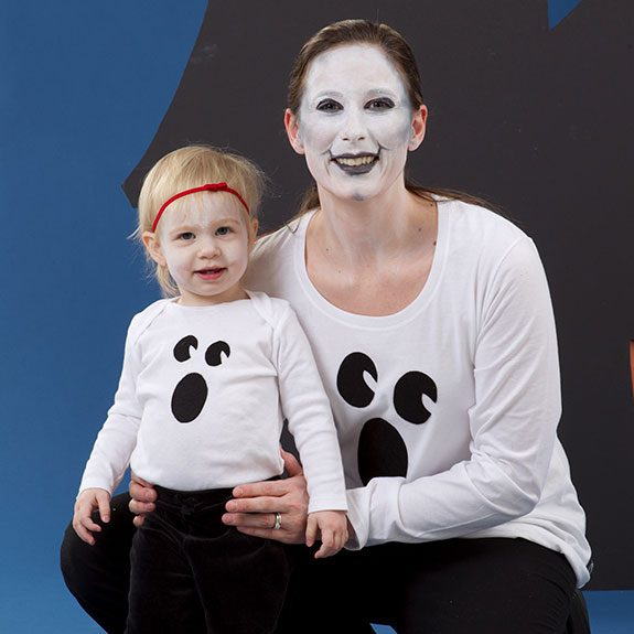Mother and daughter duo both wearing white shirts with ghost faces on them
