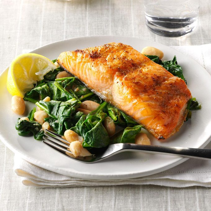 Broiled salmon with spinach and white beans.