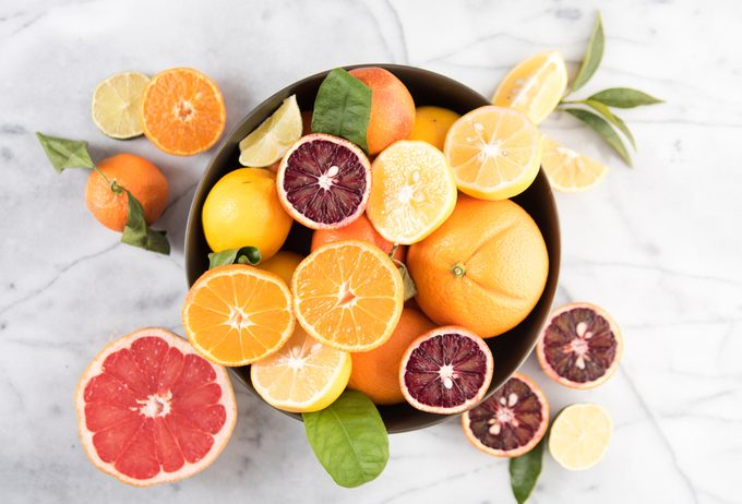 Assorted Citrus Fruit in Bowl on Marble Counter