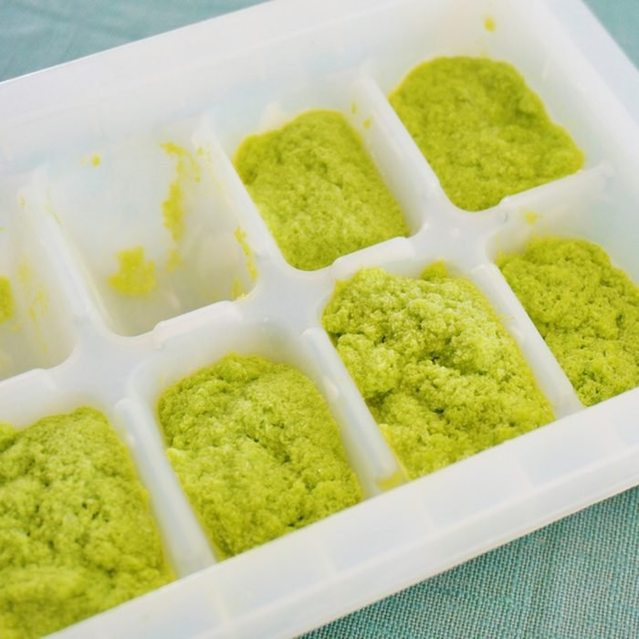 Making pesto in an ice cube tray; Shutterstock ID 438801295
