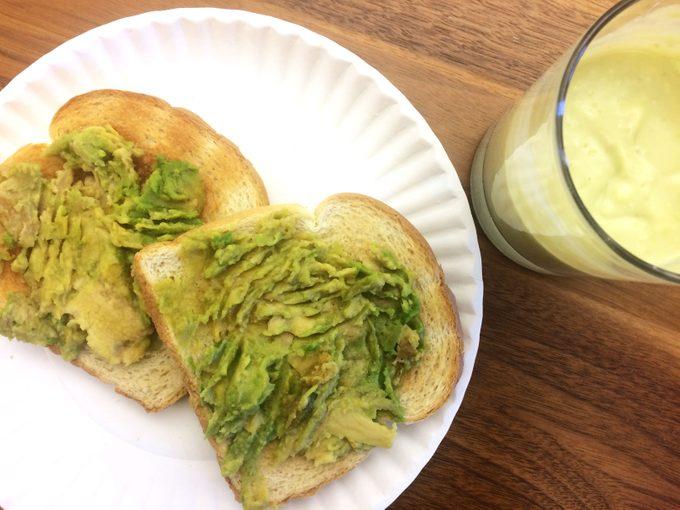Frozen avocado spread onto two slices of toast