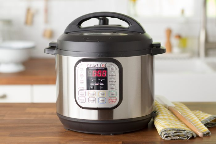 Instant pot on a wooden countertop