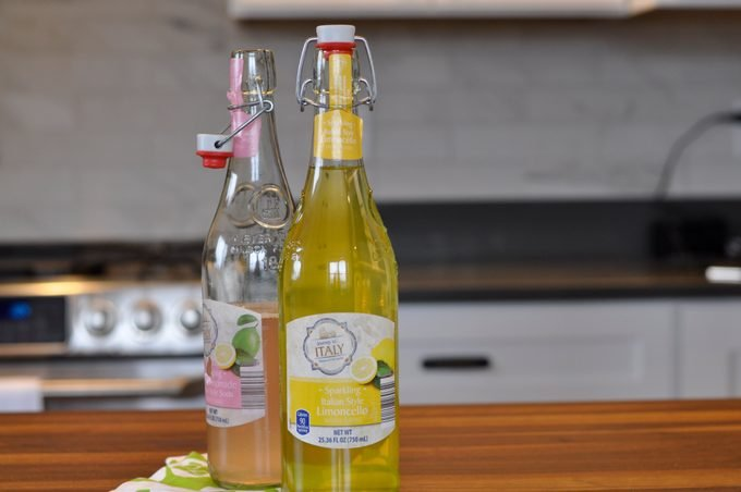 Two flavors of sparkling soda on a countertop
